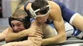 Longwood's Corey Raseed tries a cross face during