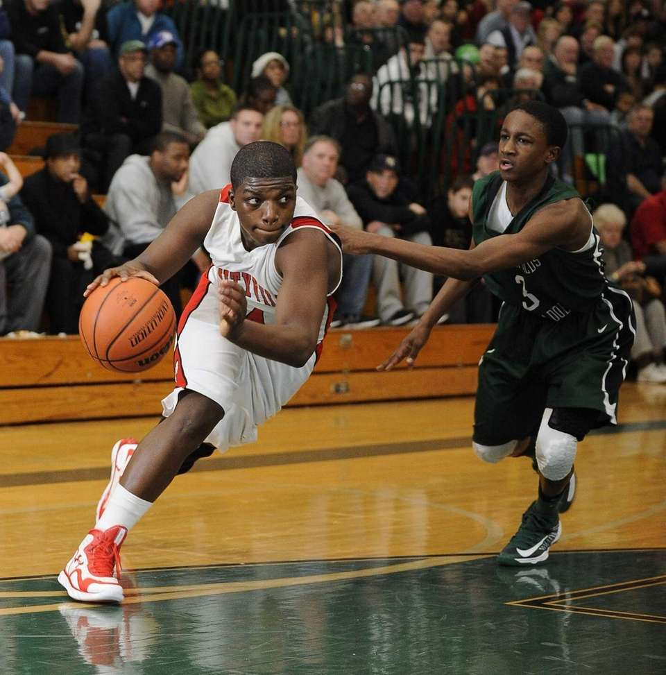 Mike Alston of Amityville drives the ball past