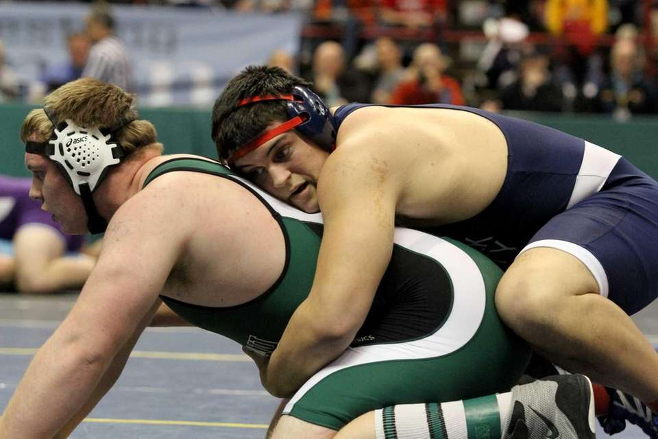Mike Hughes of Smithtown West goes against opponent