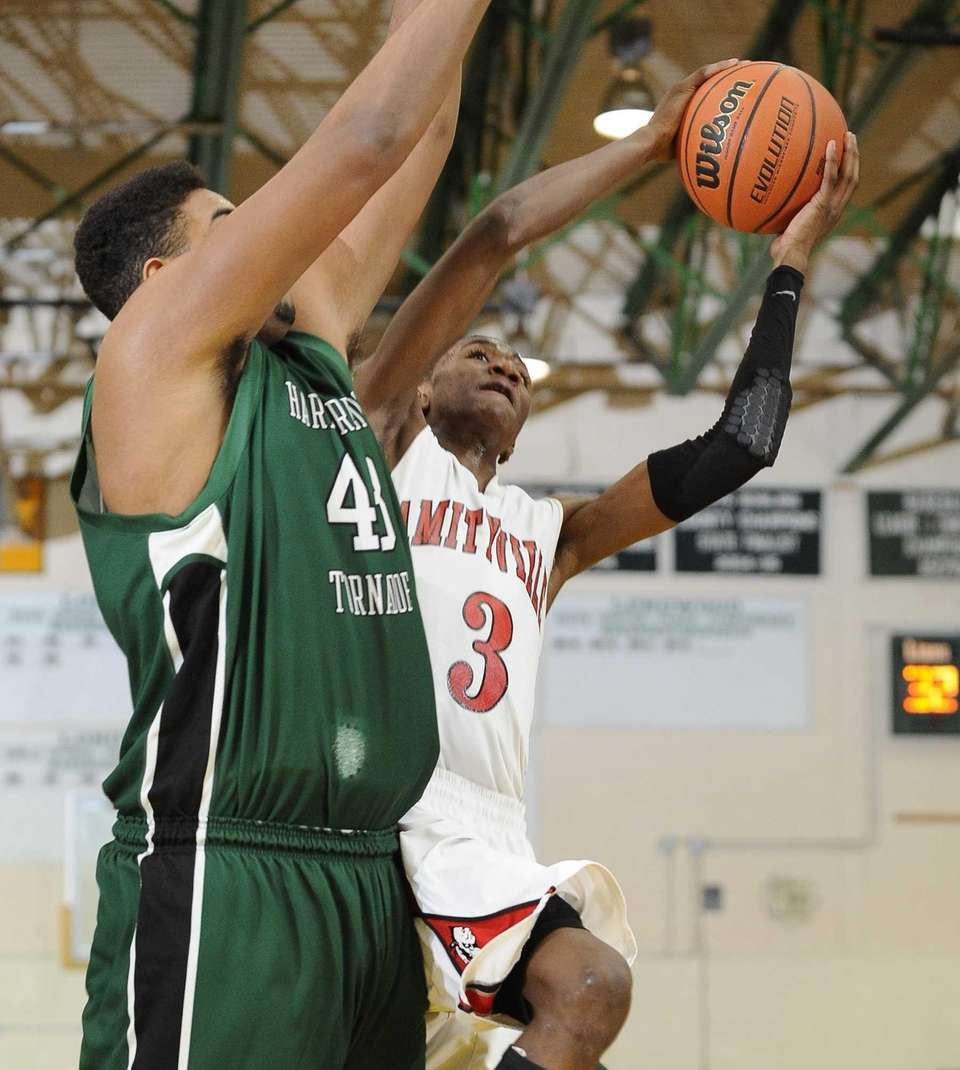 Amityville's Travis Dickerson shoots past Harborfields' Chris Brady.