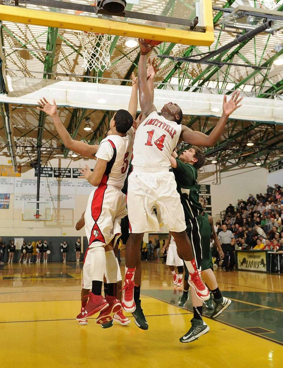 Amityville's Kavione Green tries to put up the