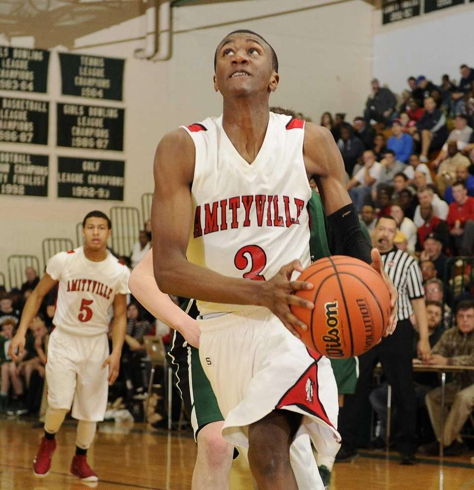 Amityville's Travis Dickerson goes up for a layup