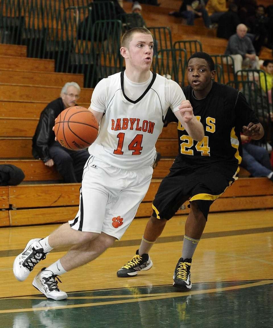 Babylon's Jake Carlock drives past Bridgehampton's Anajae Lamb