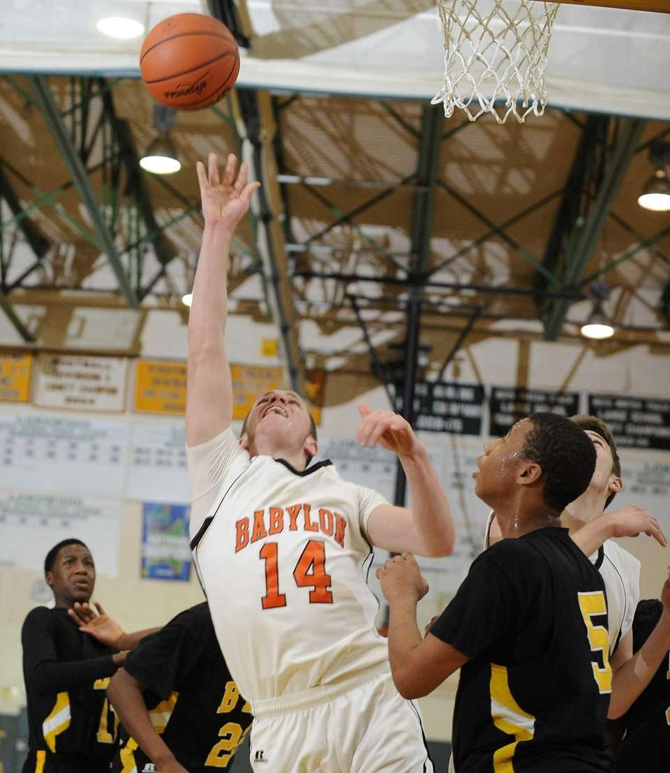 Babylon's Jake Carlock shoots against Bridgehampton in the