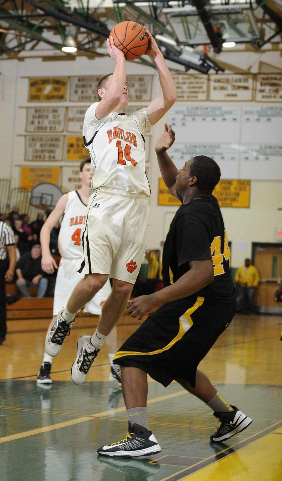 Babylon's Jake Carlock shoots a jumper over Bridgehampton's