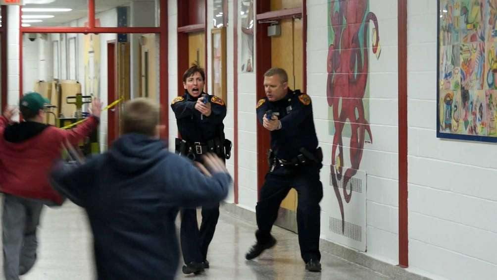 During a police tactical drill for a school