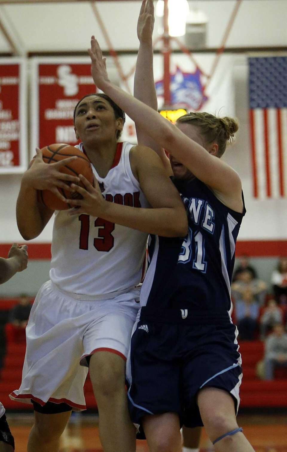 Stony Brook's Sabre Proctor is fouled in the