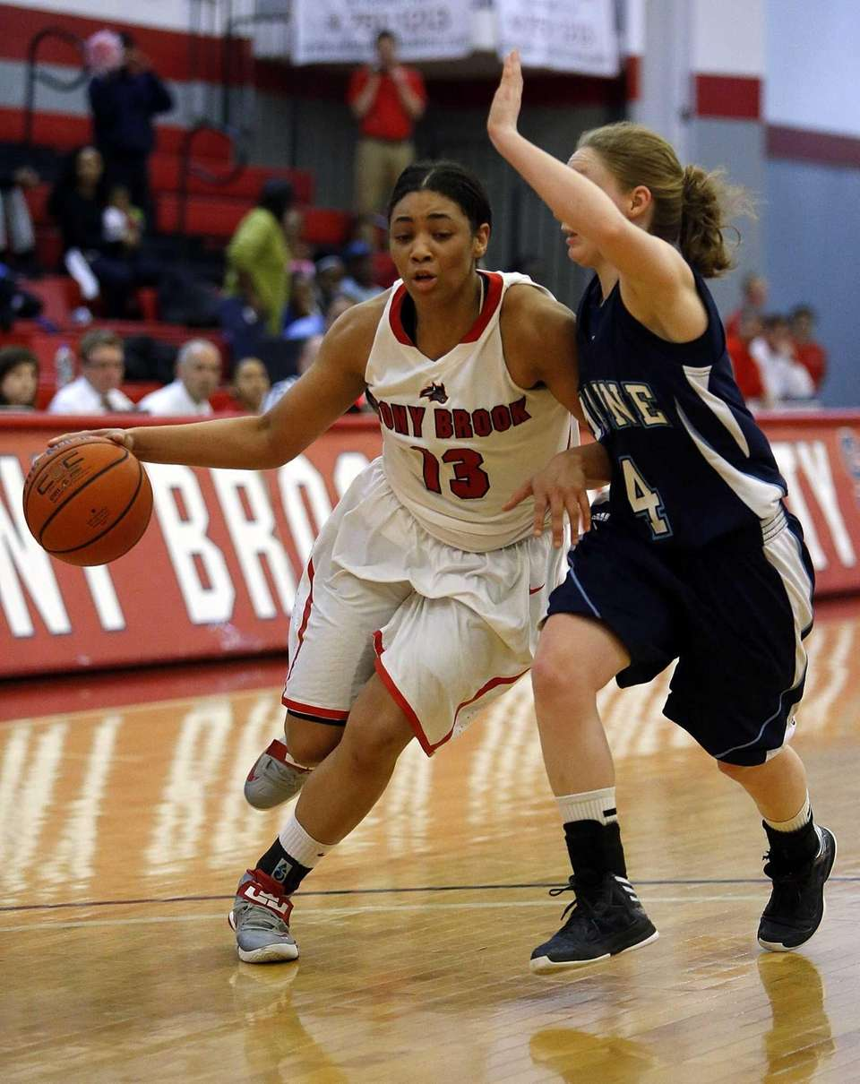 Sabre Proctor of Stony Brook drives against Maine's
