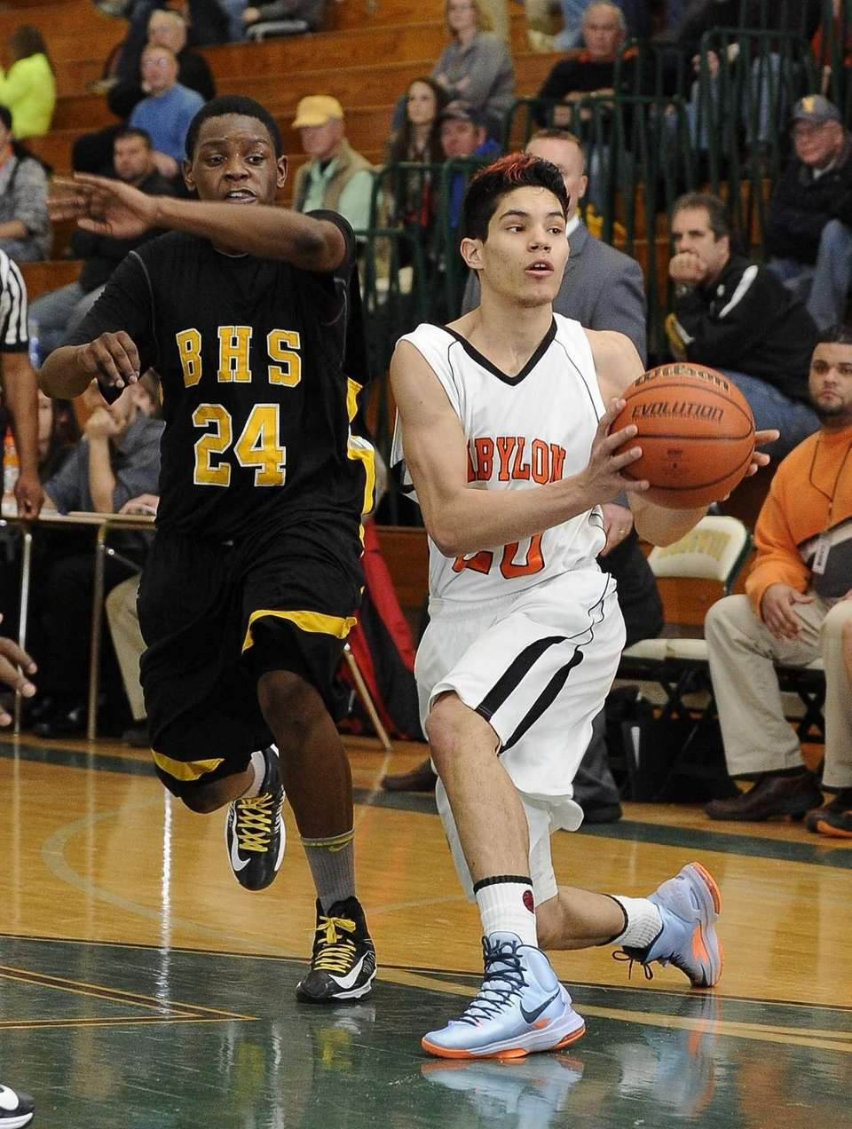 Babylon's Fernando Vasquez looks to pass ahead of