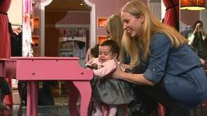 Eileen Linzer, of Lynbrook, holds her daughter Quinn