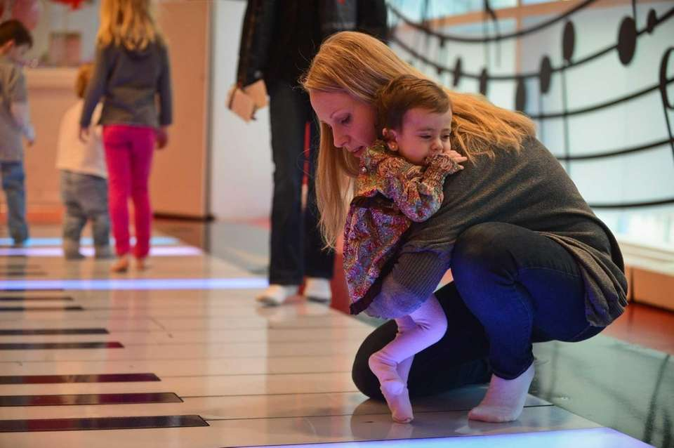 Eileen Linzer taps her daughter Quinn's feet on