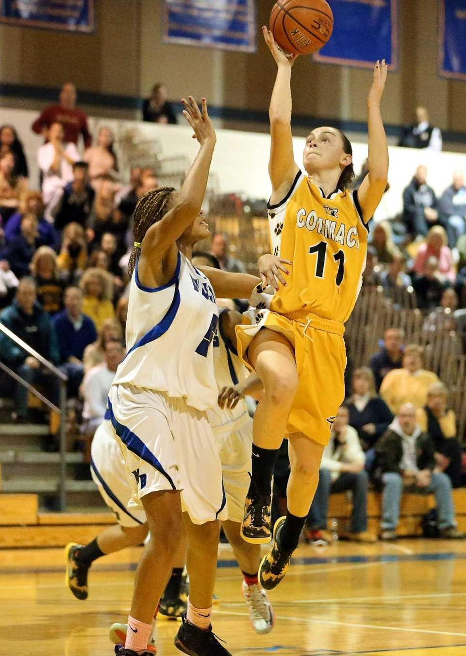 Commack's Erin Storck drives with the layup against