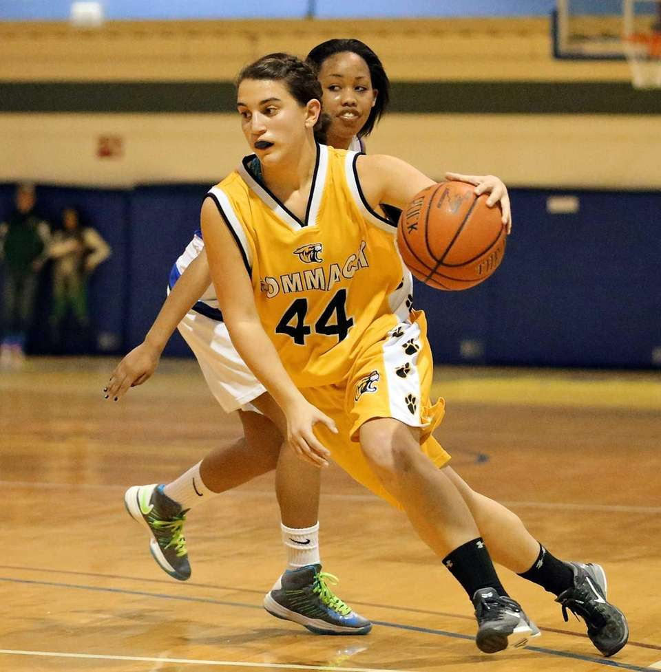 Commack's Melissa Lobacarro drive the lane in overtime