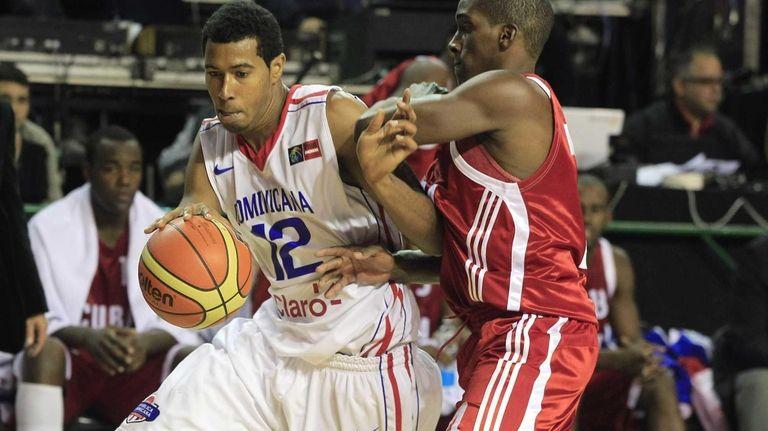 Dominican Republic's Orlando Sanchez, left, dribbles around Cuba's
