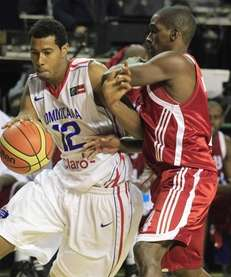 Dominican Republic's Orlando Sanchez, left, dribbles around Cuba's