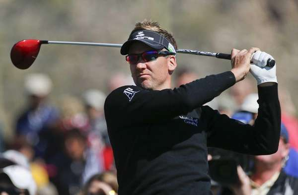 England's Ian Poulter tees off the third hole