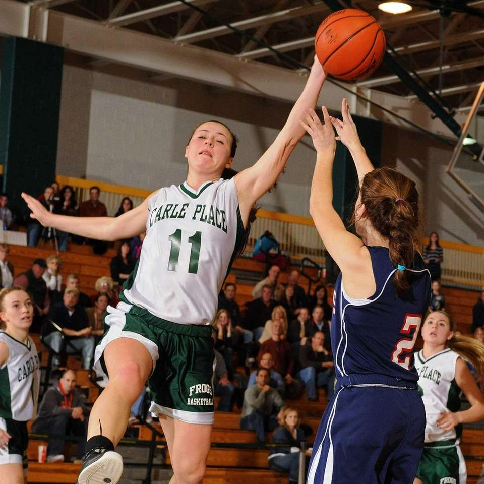 Carle Place junior Meredith McLaughlin, left, blocks a