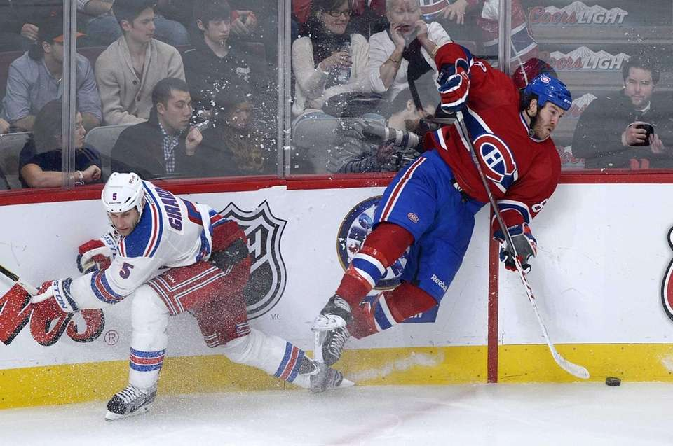 Montreal Canadiens' Brandon Prust, right, collides with Rangers'