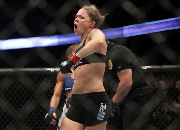 Ronda Rousey celebrates defeating Liz Carmouche after their