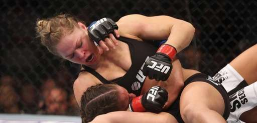Ronda Rousey hits Liz Carmouche during their UFC