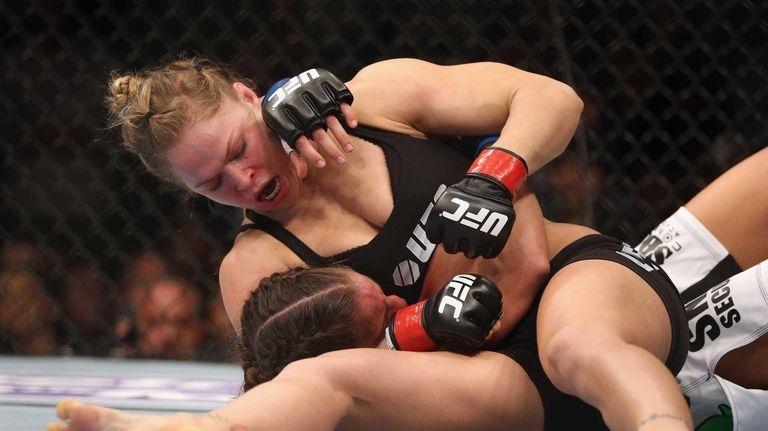 Ronda Rousey hits Liz Carmouche during their UFC