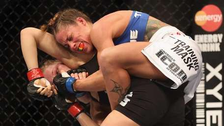 Liz Carmouche attempts to submit Ronda Rousey during