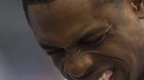 Curtis Granderson reacts after being hit with a