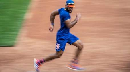 Mets shortstop Amed Rosario during a workout at