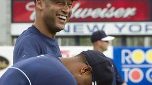 Derek Jeter and Robinson Cano share a laugh