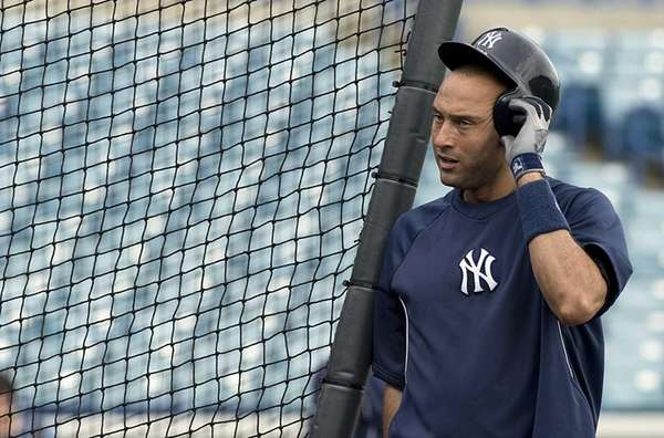 Derek Jeter takes batting practice before a spring