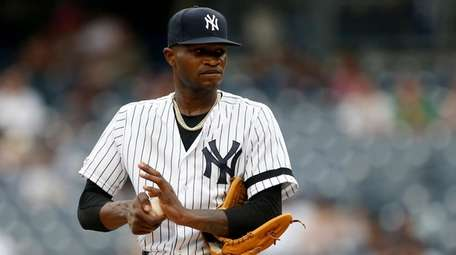 Domingo German #55 of the Yankees stands on