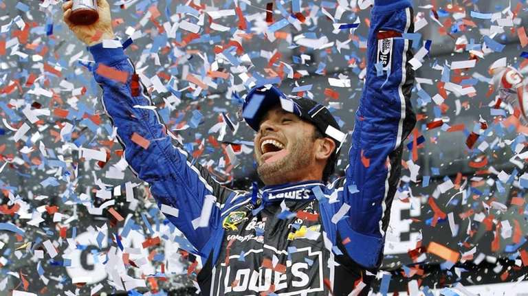 Jimmie Johnson celebrates after winning the Daytona 500