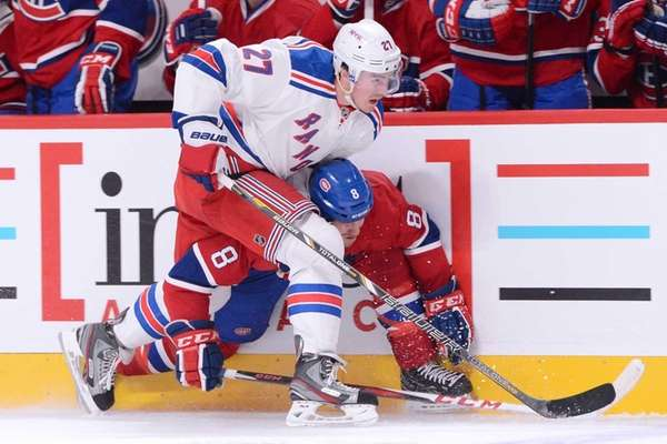 Ryan McDonagh body checks Brandon Prust #8 of
