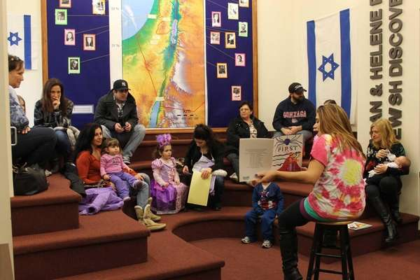 "Lara Ginsberg, 23, reads ""Sammy Spider's First Purim,"""