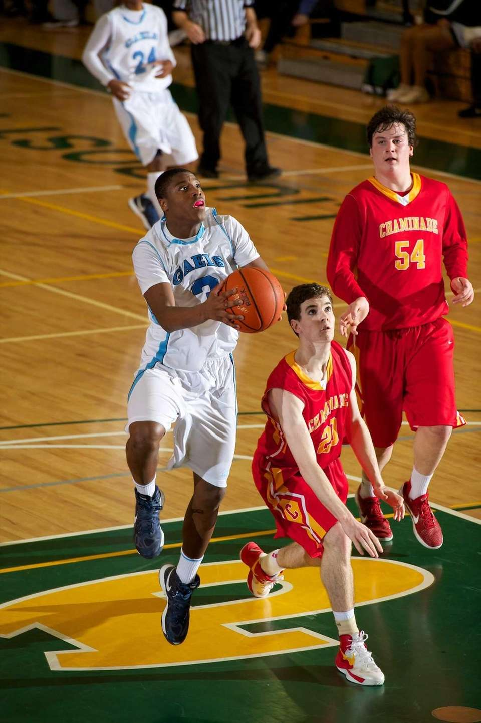 St. Mary's guard Javin Barton (3) drives to