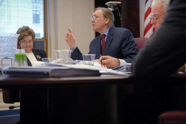 State Board of Elections commissioners, Evelyn Aquila, left,