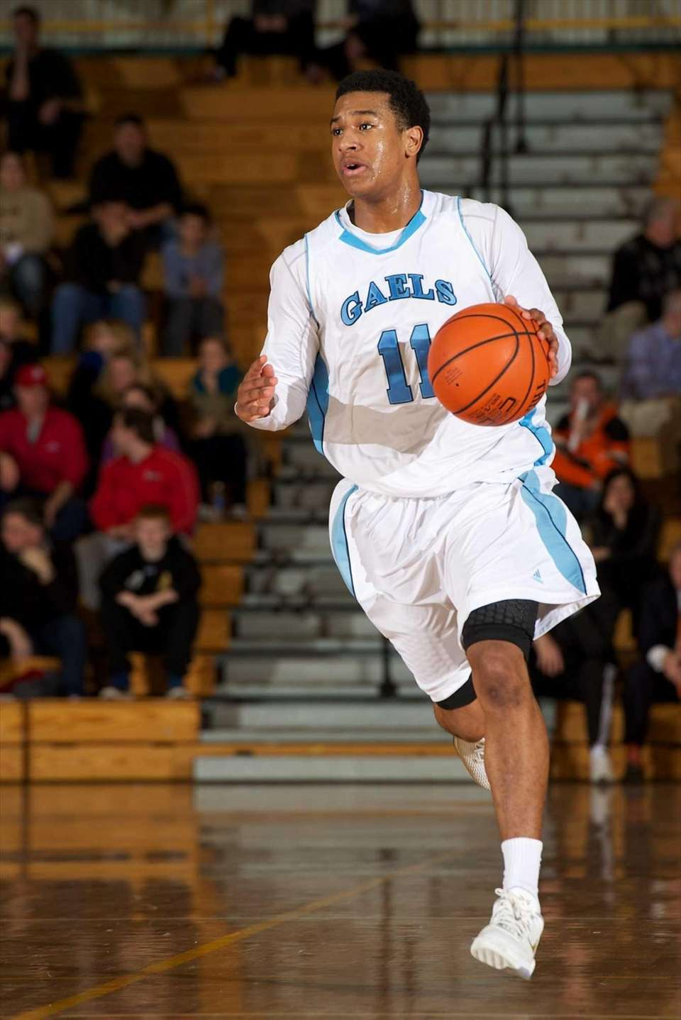 St. Mary's guard Devonte Green (11) drives to