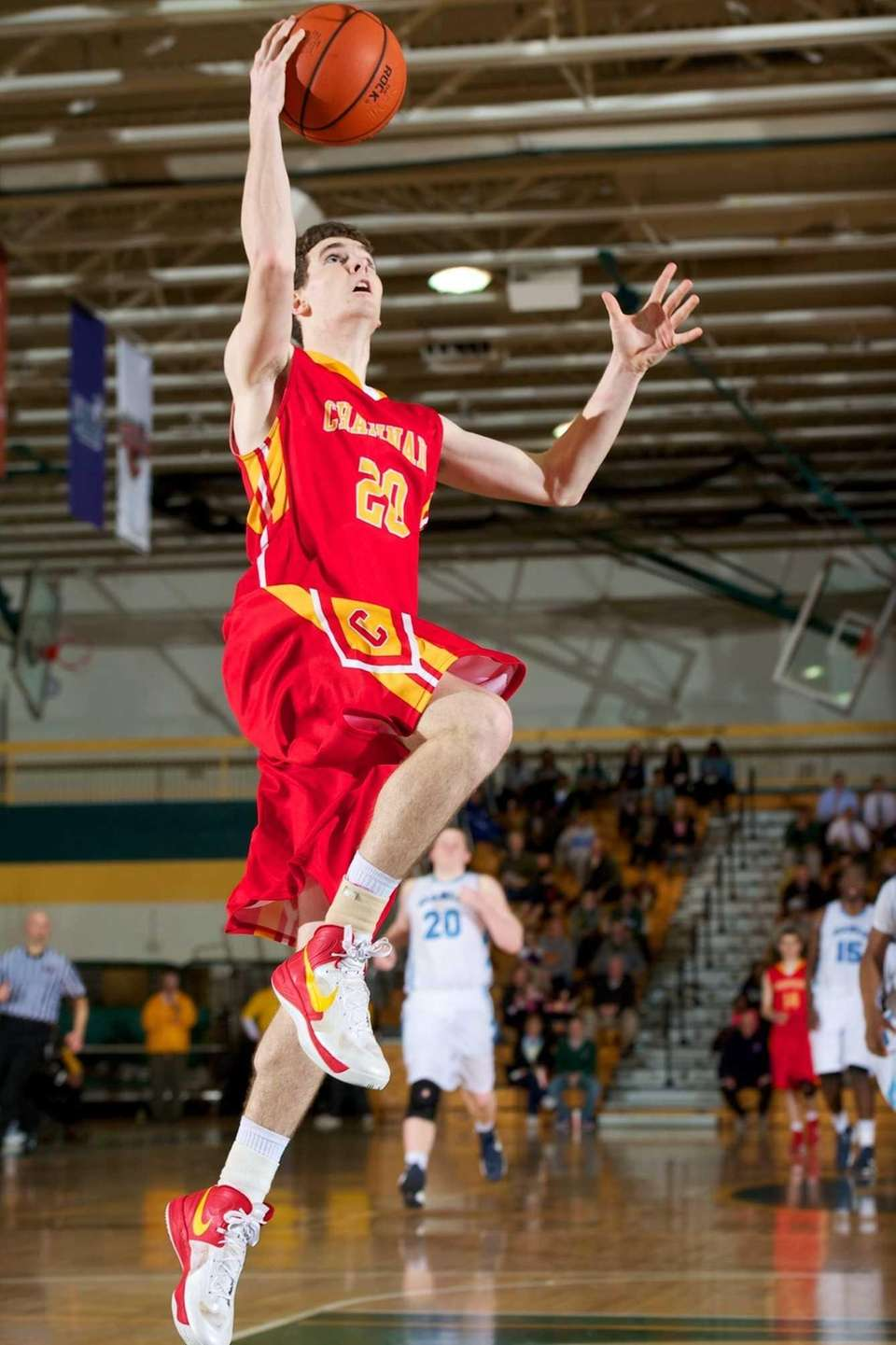 Chaminade guard Liam Murphy (20) lays the ball