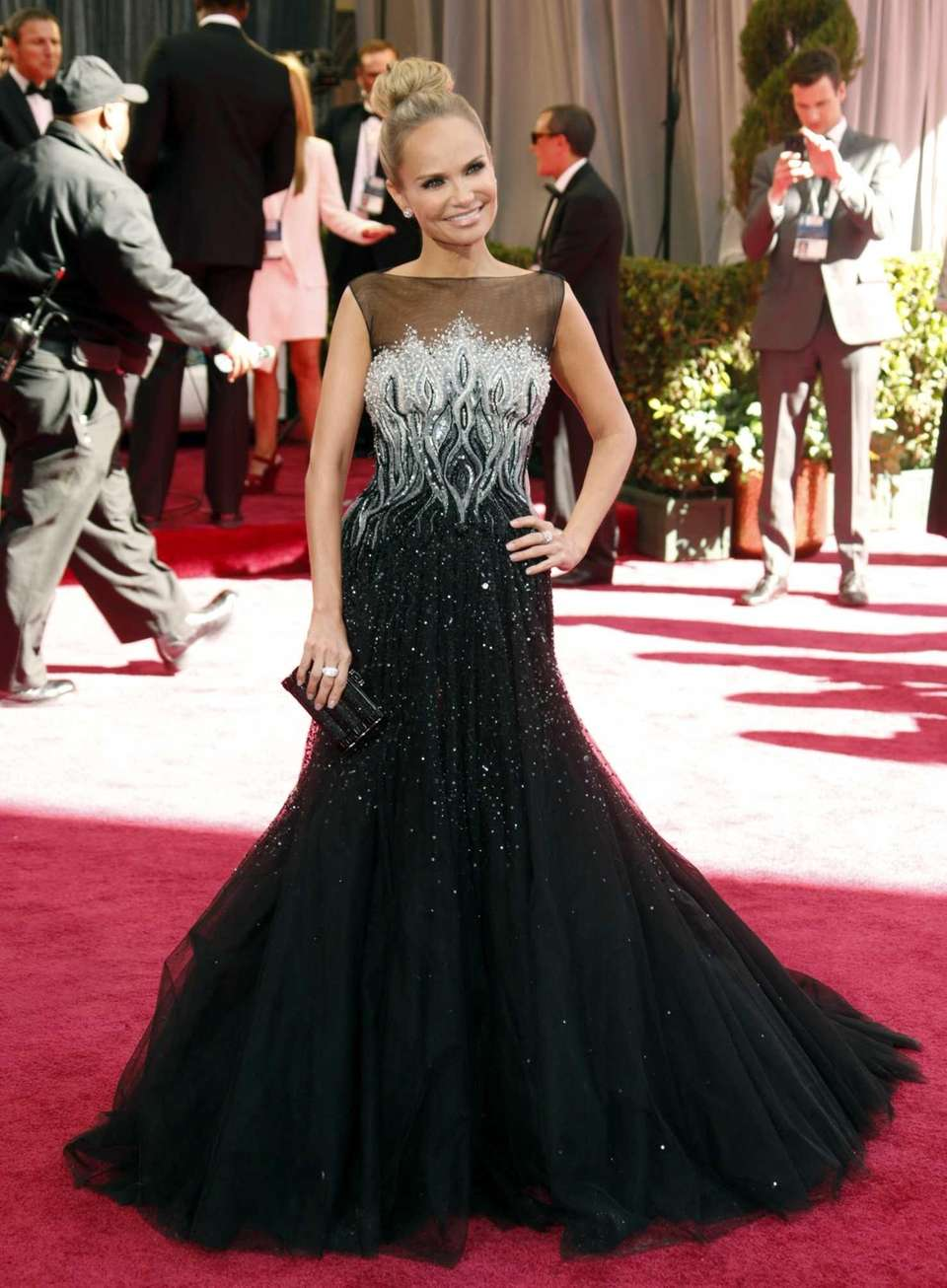 Kristin Chenoweth arrives at the 85th Academy Awards