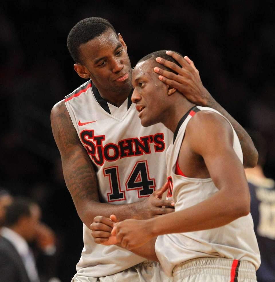 Jakarr Sampson celebrates a basket with Phil Greene