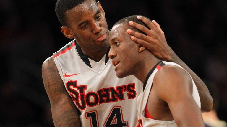 Jakarr Sampson celebrates a basket with Phil Greene