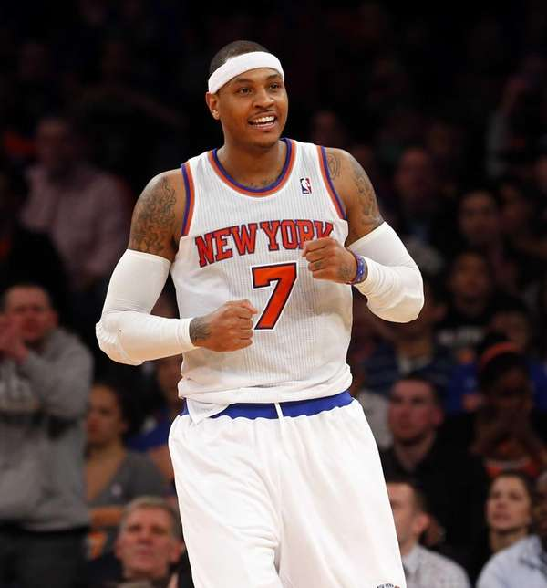 Carmelo Anthony celebrates after drawing a foul in