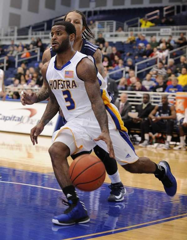 Hofstra guard Stevie Mejia drives the baseline defended