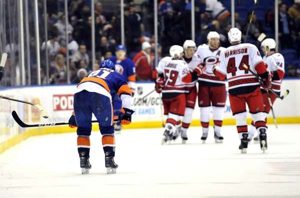 John Tavares slumps over after the Hurricanes scored