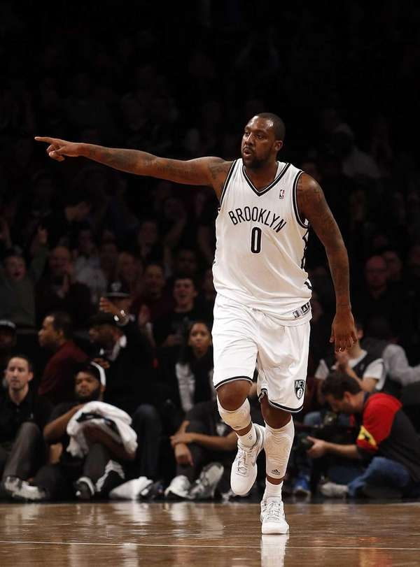 Andray Blatche celebrates a score in the second