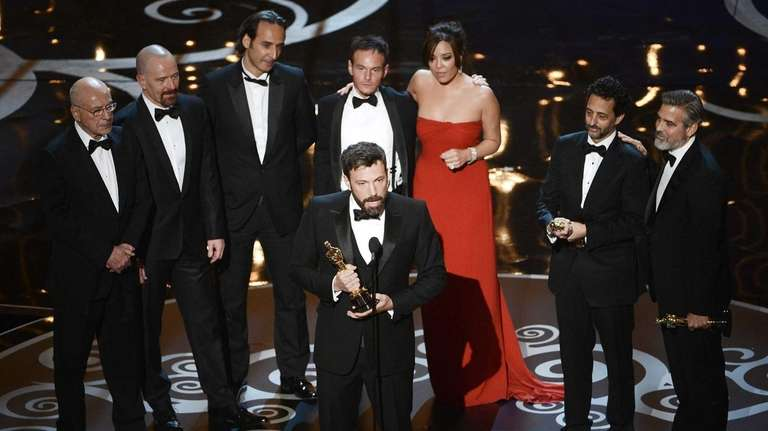Actor/producer/director Ben Affleck accepts the best picture award