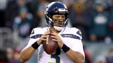 Seahawks quarterback Russell Wilson drops back to pass