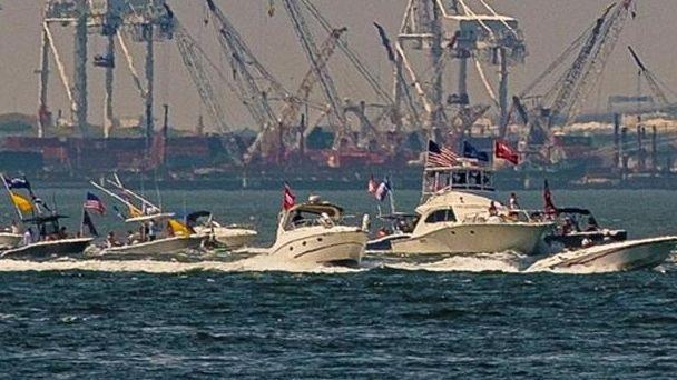 Dozens of watercraft on Sunday sailed past the