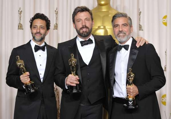 Grant Heslov, left, Ben Affleck, center, and George
