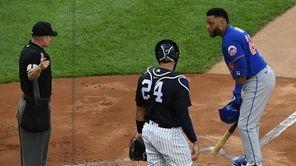 New York Mets second baseman Robinson Cano listens